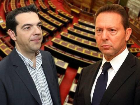 Σκληρή κόντρα Τσίπρα – Στουρνάρα στη Βουλή