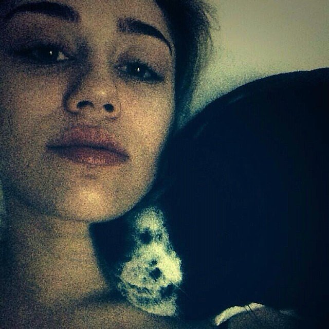Miley-Cyrus-snuggled-up-one-her-pups