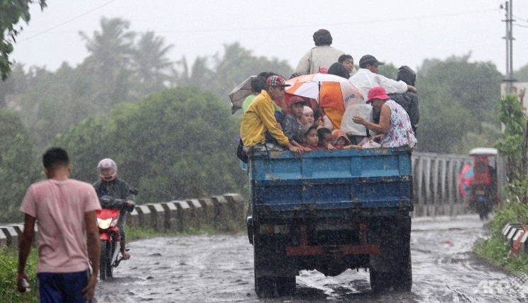At least 10 killed and 150,000 forced to evacuate as typhoon hits Philippines