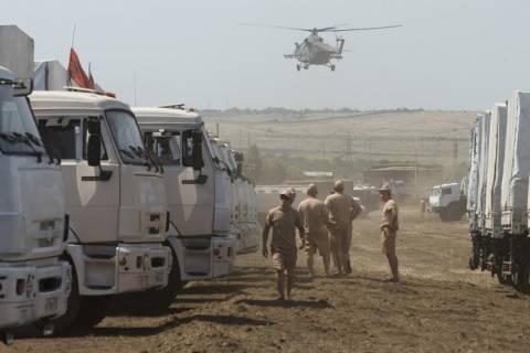Eastern Ukraine: Red Cross to receive humanitarian aid; Ukrainian guards inspect convoy