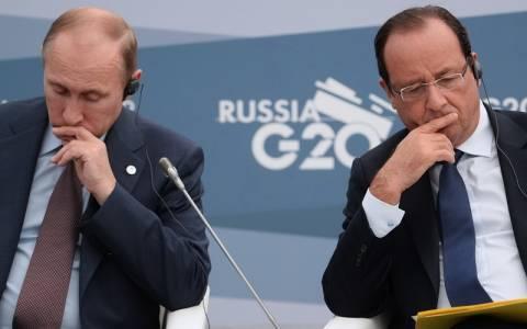 Ο Ολάντ κάλεσε τον Πούτιν να μην αναγνωρίσει τις εκλογές στην ανατολική Ουκρανία