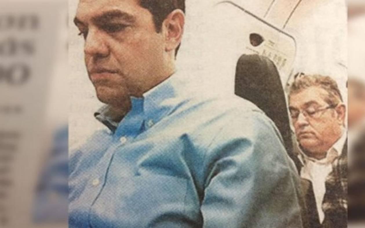 Τσίπρας - Κουτσούμπας: Δύο ξένοι στην ίδια πτήση (pic)