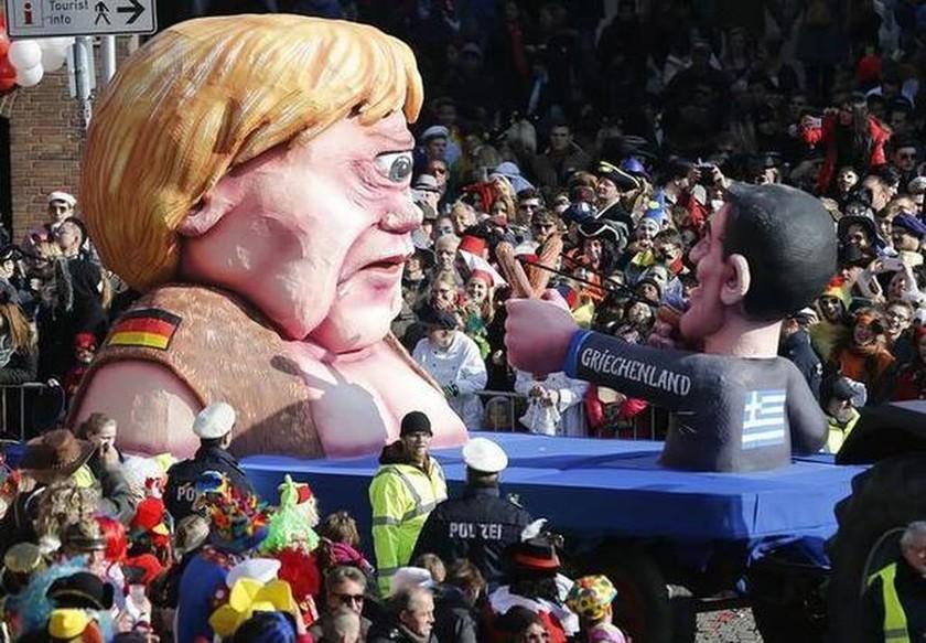 Ο Τσίπρας σημάδεψε με σφεντόνα τη Μέρκελ! (photo)