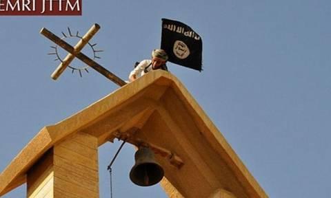 Ιράκ: Τζιχαντιστές ξηλώνουν σταυρούς από εκκλησίες (Photos)