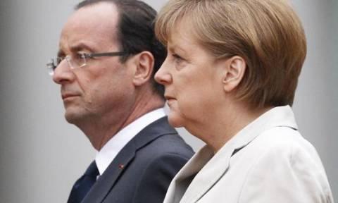 Le Monde: Μέρκελ και Ολάντ πιέζουν για συμφωνία με την Ελλάδα
