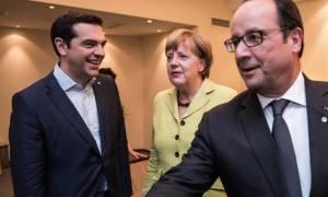 Le Monde: Η ελληνική κρίση βάζει σε δοκιμασία το γαλλο-γερμανικό ντουέτο