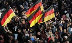Διχασμένοι οι Γερμανοί για το ελληνικό πρόγραμμα στήριξης