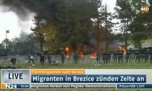 Πρόσφυγες πυρπόλησαν τον καταυλισμό τους στη Σλοβενία απαιτώντας να φύγουν (photos)