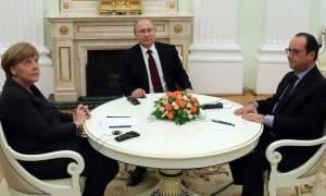 Διαπραγματεύσεις Πούτιν με Μέρκελ και Ολάντ για πολιτική λύση στην Ουκρανία