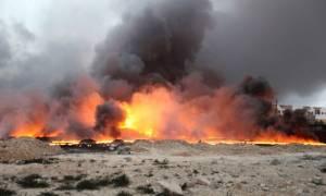 Εικόνες Αποκάλυψης στο Ιράκ: Εκρήξεις, ποτάμια πετρελαίου και φλεγόμενοι δρόμοι (videos+photos)