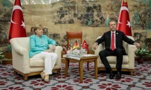Germany's Merkel upbeat on improving ties with Erdogan after meeting