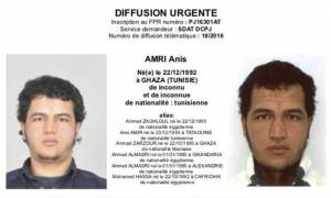 Germany police hunt Tunisian asylum-seeker over Christmas market attack