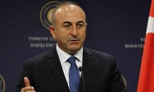 Κυπριακό: «Αρπάχτηκαν» Γιουνκέρ – Τσαβούσογλου