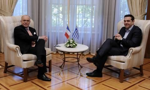 Τσίπρας: Εφικτή η συμφωνία στο Eurogroup του Μαρτίου - Καζνέβ: Έχουμε κοινούς σκοπούς με την Ελλάδα