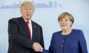 Γερμανία: Έδωσαν τα χέρια Μέρκελ - Τραμπ