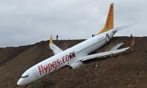 Εικόνες - σοκ: Αεροπλάνο γλίστρησε στο γκρεμό κατά την προσγείωση (pics+vid)