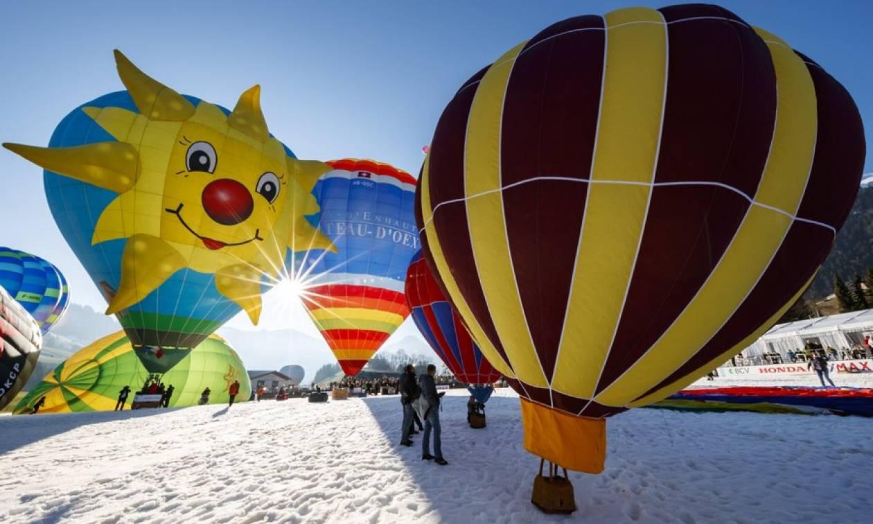 Εντυπωσιάζουν τα δεκάδες αερόστατα πάνω από τις χιονισμένες Άλπεις (pics)