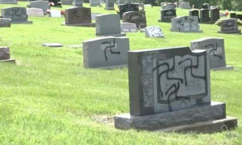 Βεβήλωσε νεκροταφείο ζωγραφίζοντας τη σβάστικα στις ταφόπλακες (vids)