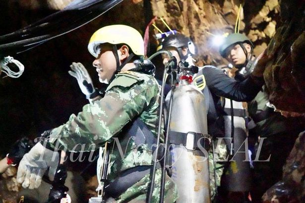 Rescue personnel work at the Tham Luang cave complex as members of an under 16 soccer team and thei