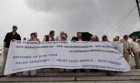 Διαμαρτυρία στο Σύνταγμα: «Το Βερολίνο οφείλει στην Αθήνα, το δάνειο της κατοχής πληρώσαμε με πείνα»