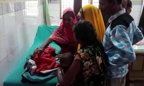 Εικόνες - ΣΟΚ! Γυναίκα γέννησε μωρό με τρία κεφάλια