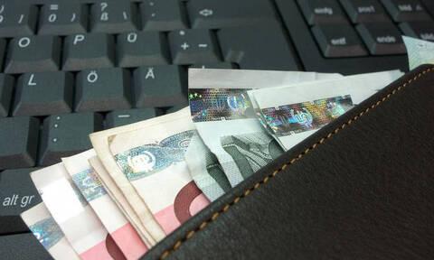Χρέη προς το Δημόσιο: Πότε «ξεμπλοκάρουν» οι τραπεζικοί λογαριασμοί με τη νέα «πάγια» ρύθμιση