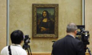 Η Μόνα Λίζα ξαναβρήκε τη θέση της στο Λούβρο (photos)