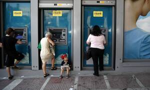 National and Piraeus Banks suspend selective customer fees at ATMs