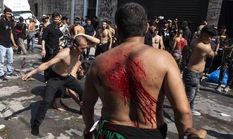 Σιίτες μουσουλμάνοι αυτομαστιγώθηκαν στο κέντρο του Πειραιά - Σκληρές εικόνες