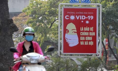 Πινακίδα προστασίας για τον κορονοϊό στο Βιετνάμ